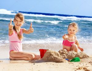 depositphotos_6101743-stock-photo-kids-playing-on-beach